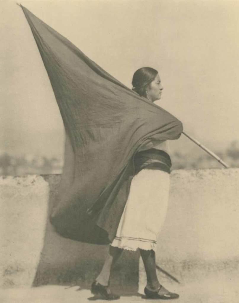 Woman-with-flag-1928_Tina-Modotti_Courtesy-of-Throckmorton-Fine-Art